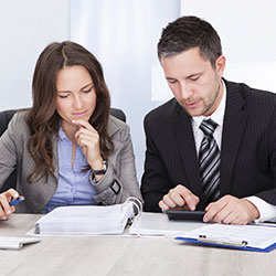 Accountant and tax agent providing tax advice to a client.